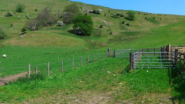 Walker approaching Culdoch on the path from Craigendower
