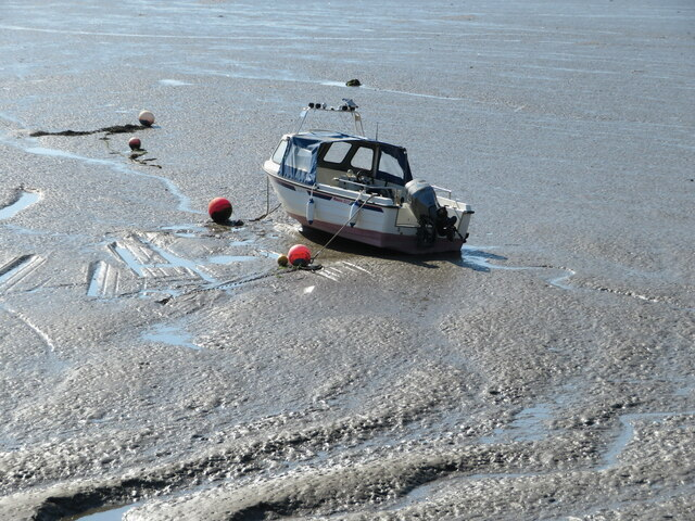 Boat in the mud in West Dock, Burry Port Harbour