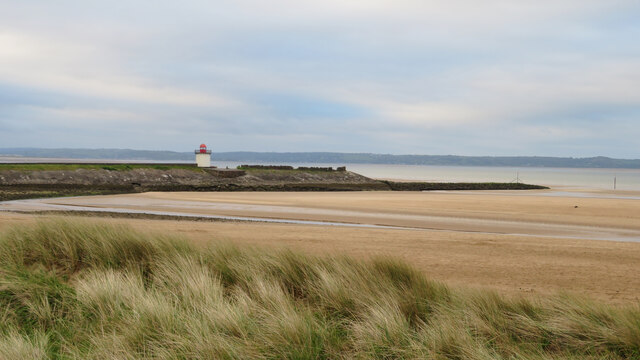 View over the dunes to Burry Port breakwater and lighthouse