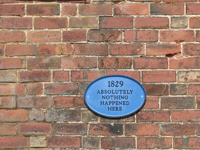 Blue plaque on outbuilding at Beaconsfield House, Burton Joyce