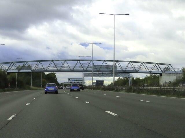 The A2 heading west under a footbridge