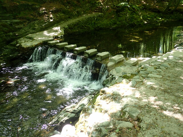 Restored weir and stepping stones between the Hermitage and the Meeting of the Waters