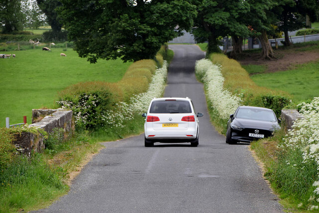Cars pass along Dryarch Road