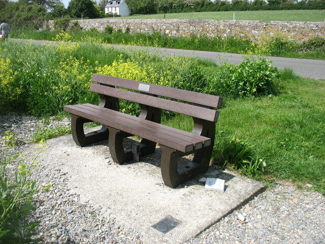 A memorial bench overlooking the Menai Strait