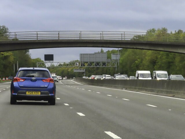 The M25 runs under Combe Bank Drive