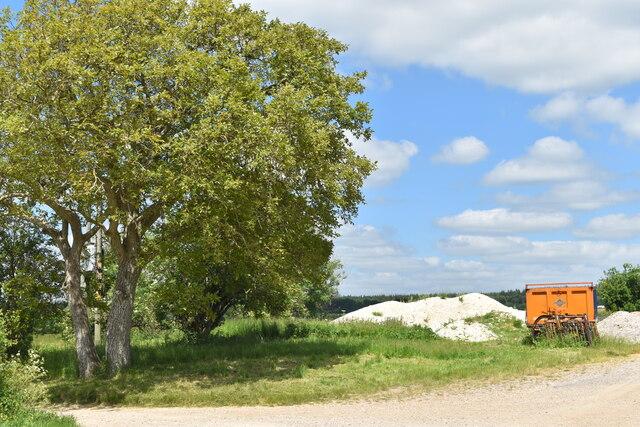 Trees and farm equipment at North Burcombe