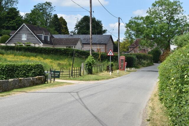 Village street past Burcombe Manor