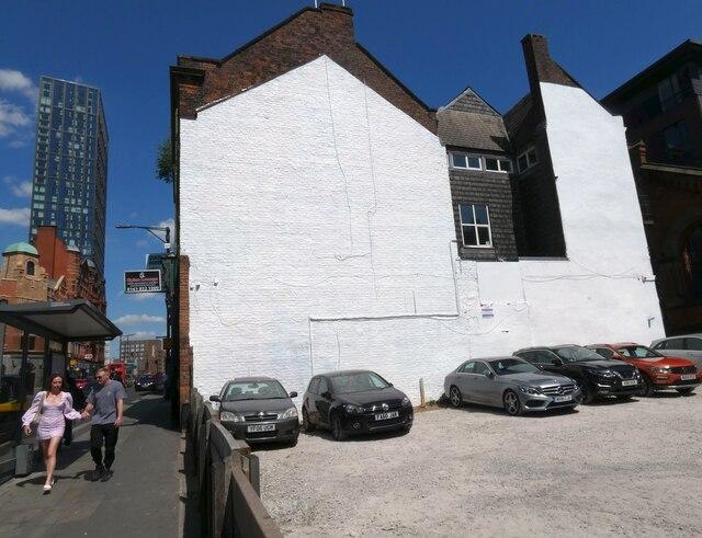 A whitewashed wall on Shudehill