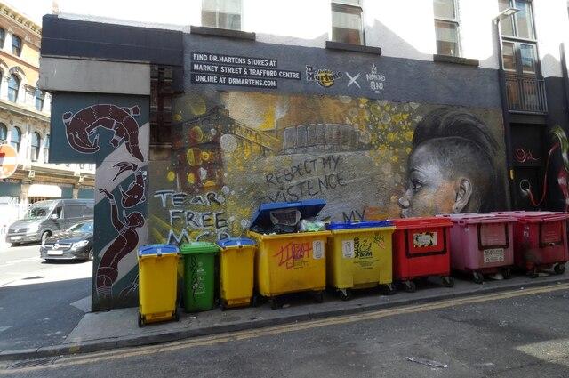 Wheelie bins and a mural