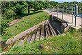 TQ2748 : Weir, Upper Lake by Ian Capper