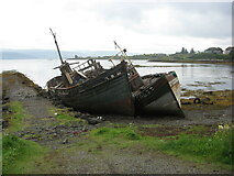 NM5643 : Abandoned boats at Salen by T  Eyre