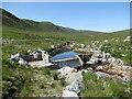 NN4362 : Small hydroelectric weir, Allt Eigheach by Alan O'Dowd