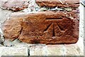 NY5536 : Benchmark on the tower of St Cuthbert's Church by Roger Templeman