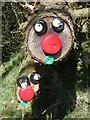 SN4727 : Addurnad ochr heol ger Allt Dolgafros / Roadside decoration by Dolgafros Wood by David Jones