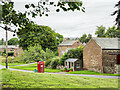NY6039 : Repurposed telephone box in Gamblesby by Trevor Littlewood