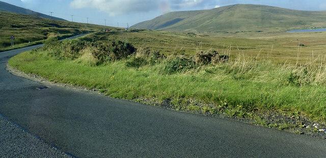 The B27 (Hilltown-Kilkeel) road swinging south towards the gap between Slieve Muck and Pigeon Mountain