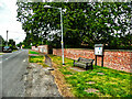 SK8572 : Churchyard wall, Main Street, Thorney by Humphrey Bolton