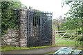 SO3503 : Ornamental gate (L), The Spinney, Estavarney Lane by M J Roscoe