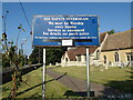 TL4958 : All Saints Church sign by Geographer
