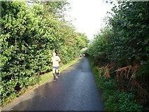 SK1408 : Runners on Darnford Lane by Richard Law