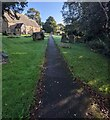 SO3402 : Path through St Matthew's churchyard, Monkswood by Jaggery