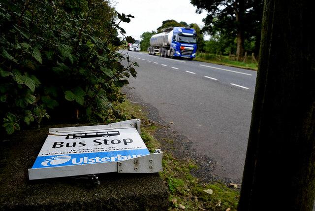 Fallen down bus stop sign, Raw