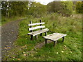 NS5579 : Seat and table beside the Old railway line by Richard Sutcliffe