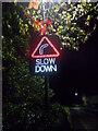 TF1505 : Illuminated slow down sign on High Street, Glinton by Paul Bryan