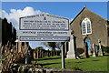 NX0268 : Kirkcolm Church & Name Sign by Billy McCrorie