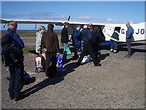 HT9737 : Baggage handling at Foula airstrip by Lis Burke