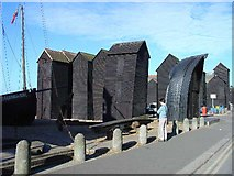 TQ8209 : Net houses next to the beach, Hastings, East Sussex by Pete Chapman