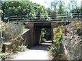 TQ2351 : Railway Bridge over narrow country lane by Hywel Williams