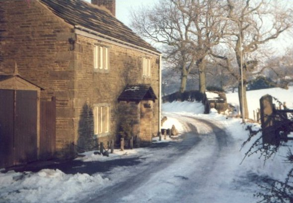 A cottage at Tarden, Mellor, in the snow