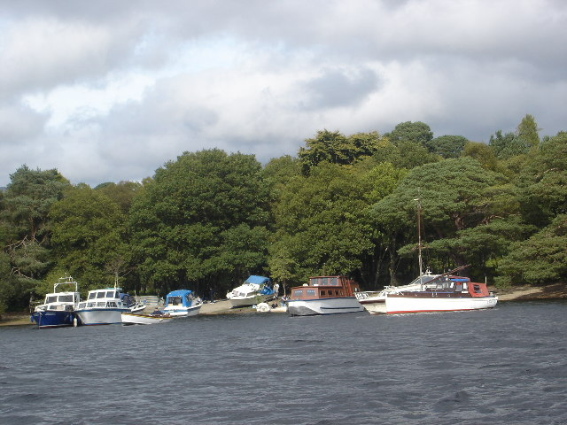 Boats moored in bay on west side of Inchconnachan, Loch Lomond