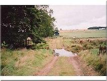 NT9705 : Ford and farmland near Burradon by Andrew Smith