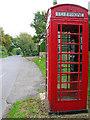 TQ5209 : Telephone box, Chalvington by Simon Carey