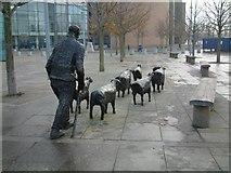 J3474 : Shepherd and Sheep Sculpture by Steve Edge