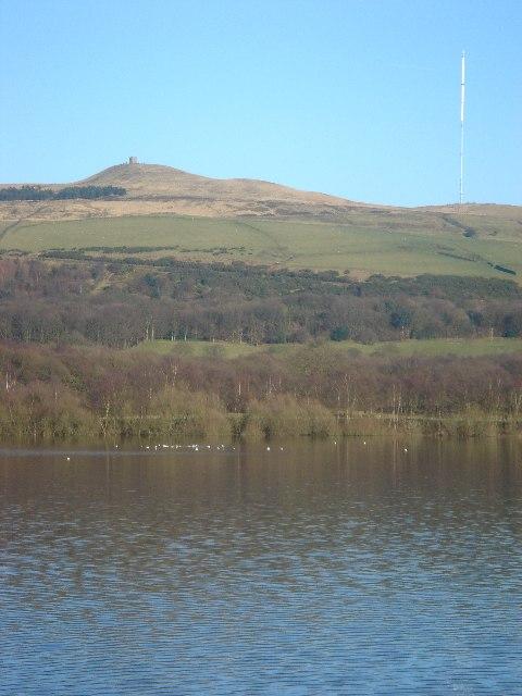 View across Rivington reservoir to Rivington Pike and Winter Hill Transmitter.