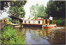 SU7251 : Narrowboat navigating past the Bascule Bridge at Odiham Castle. by Colin Smith