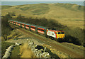 NY7702 : Train near Sandpot, Mallerstang by John Armitstead