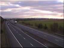 NS6965 : Looking south down M73 from Commonhead Road by Chris Upson