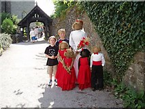 SD9772 : Scarecrow wedding at the church in Kettlewell by John Turner