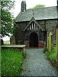 NY3459 : Porch, St Marys Church, Beaumont by Alexander P Kapp