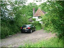 TQ0241 : Cottage by Horsham Road by Andrew Longton