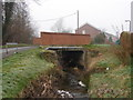 SO0392 : Bridge Over Stream, Caersws by John Lucas
