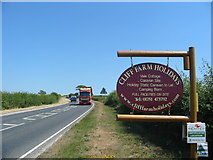 SE7485 : The A170 at Cliff Farm Holidays entrance near Sinnington by Phil Catterall