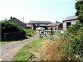 NY2556 : Studholme Farm by Oliver Dixon