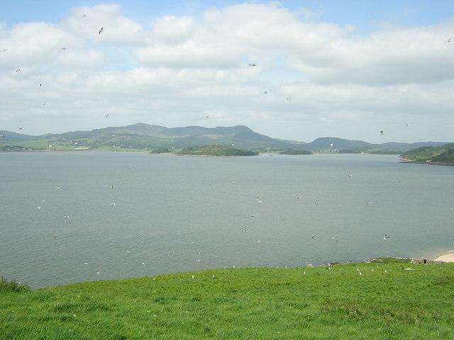 Torr Point with Bengairn Hills behind, across Auchencairn Bay