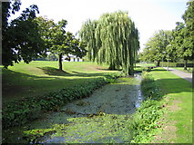 TQ2794 : Pymme's Brook in Oak Hill Park, East Barnet by Nigel Cox