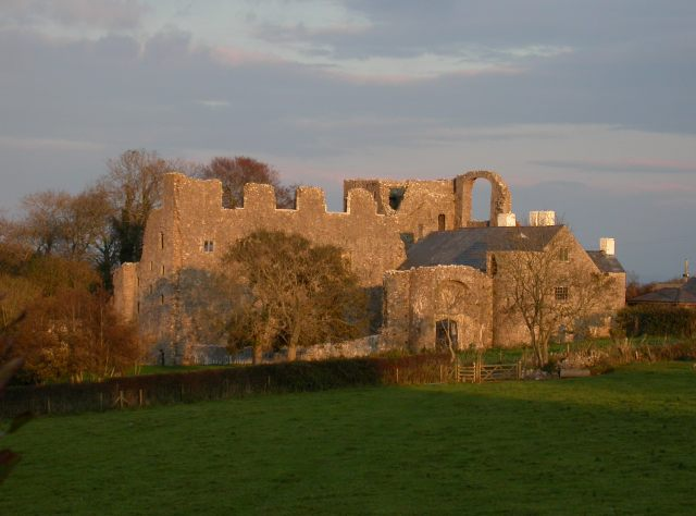 Oxwich Castle in setting sun